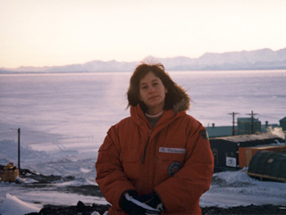 Susan Solomon, bundled among the Antarctic landscape.